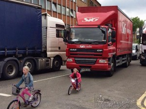 Would you design a road to force children to cycle in front of large vehicles?